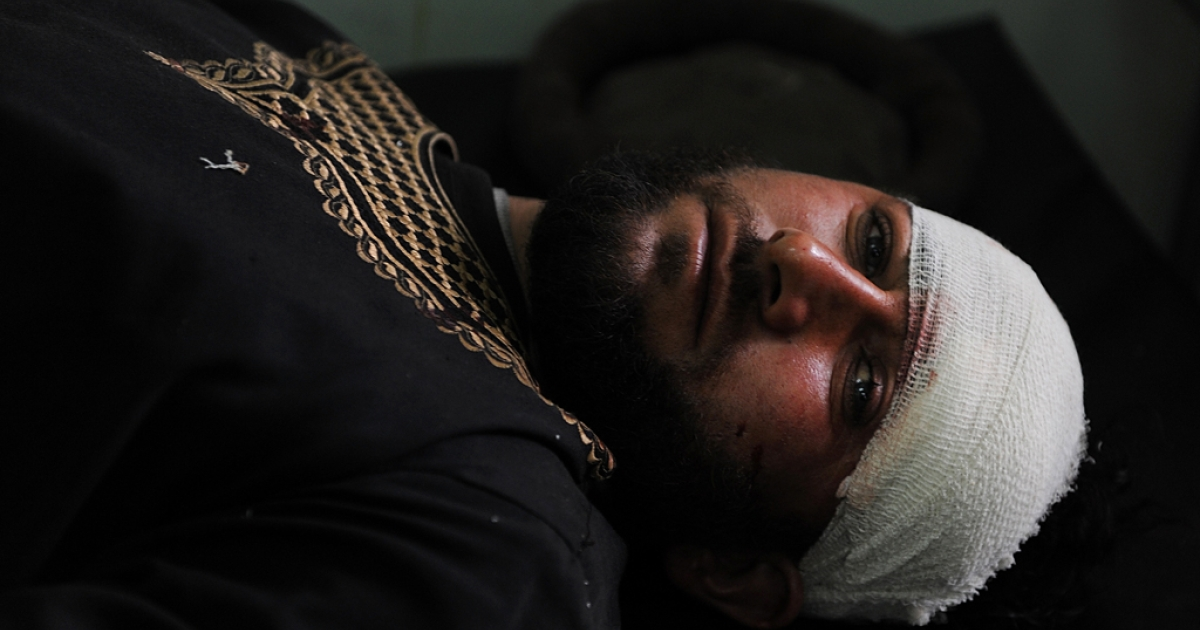 A suicide attack survivor recuperates at a hospital in Kabul on Dec. 27, 2013.</p>
