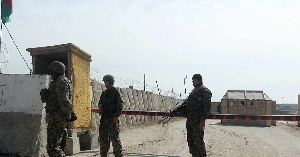Afghan National Army (ANA) soldiers stand guard at the Bagram prison gate, some 30 miles north of Kabul on Feb. 13, 2014.</p>