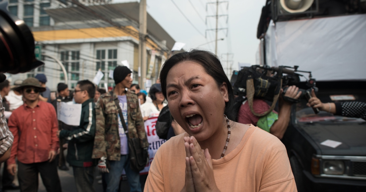 A Thai pro-election activist shouts slogans in Laksi district of Bangkok on Feb. 1, 2014.</p>
