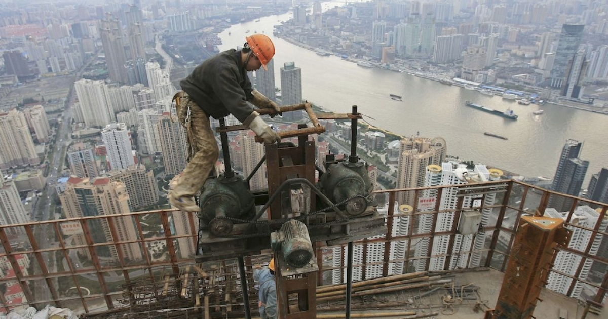 A man works on the construction site of the Shanghai World Financial Center in 2006. China's quest for natural resources is enormous, but not as big as many claim.</p>