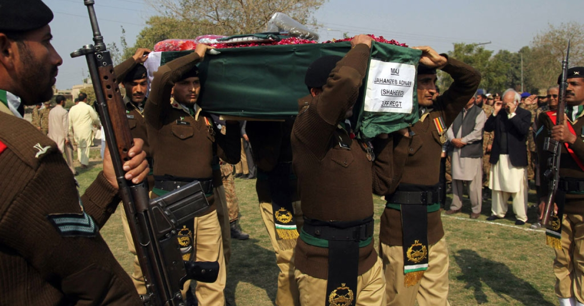 Pakistani soldiers carry the coffin of Major Jahanzeb Adnan, who was killed in an attack by militants near the northwestern city of Peshawar, at a funeral in Multan on Feb. 20, 2014.</p>