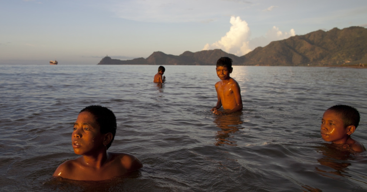 East Timorese boys swim at a capitol city beach in April 2012.  Better known for its wars and poverty, this tiny nation has produced a Olympic skier, in one of history's more quixotic Olympic journeys.</p>