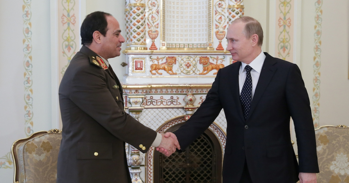 Egyptian army chief Abdel Fattah al-Sisi shakes hands with Russian President Vladimir Putin during their meeting on Feb. 13, 2014.</p>
