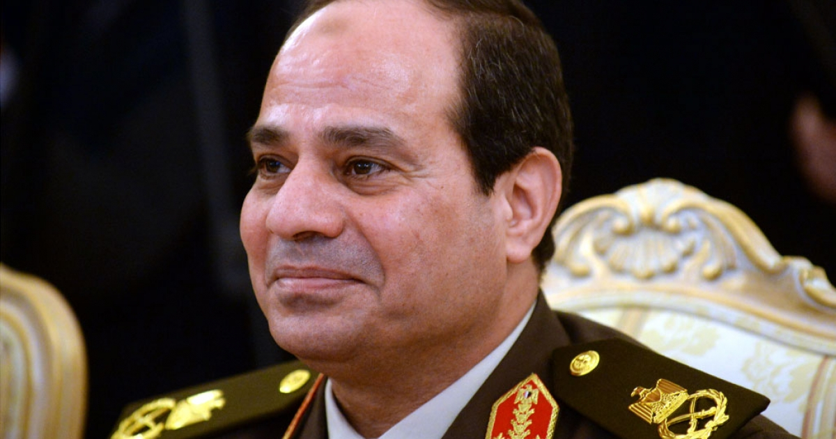 Egyptian army chief Abdel Fattah Al-Sisi smiles during his meeting with Russian Defense Minster Sergei Shoigu and Foreign Minister Sergei Lavrov in Moscow, on Feb. 13, 2014.</p>