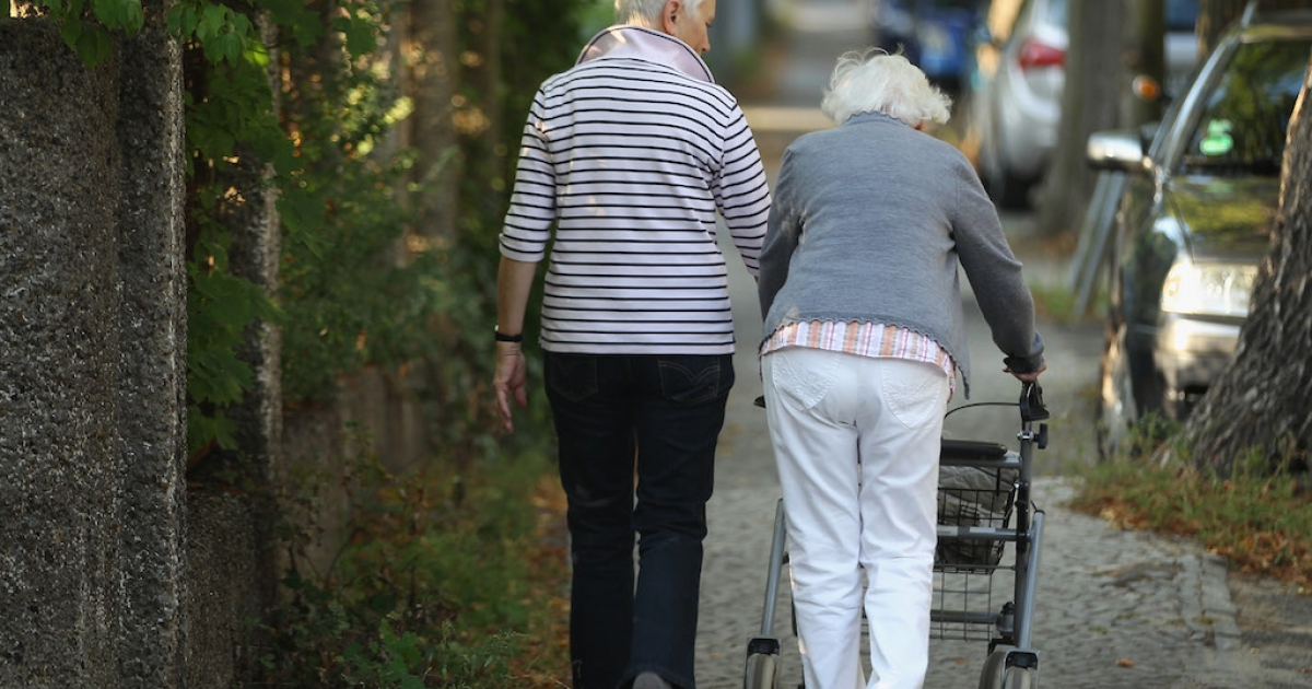 Two elderly women walk along a street in Berlin, Germany, on Sept. 18, 2012.</p>