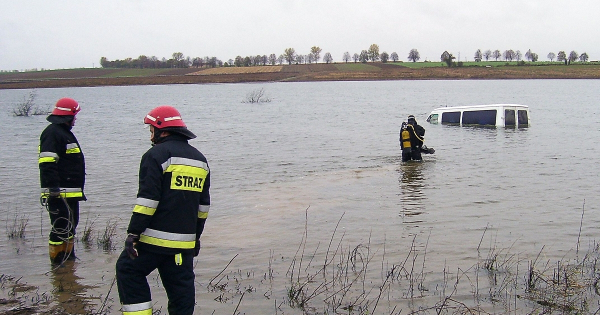 Firemen stand in an artificial lake near the partly submerged van of a Polish driver who drove the vehicle into the water after following the instructions of his GPS unit on Oct. 23, 2008 in Glubczyce. The road, closed for over one year since being flooded by the creation of the lake, was taken by the driver who neglected to see three road signs before ploughing into the waters.</p>