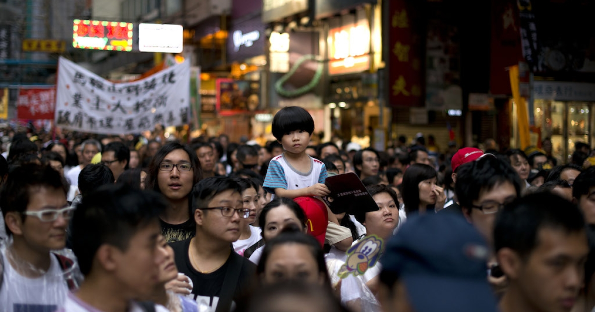 Protesters rally for democracy in Hong Kong on July 1, 2013, the 16th anniversary of the Hong Kong Special Administrative Region (HKSAR). Tens of thousands of protesters marched through torrential rain chanting slogans demanding universal suffrage. In the coming months, Beijing will decide whether to grant it.</p>