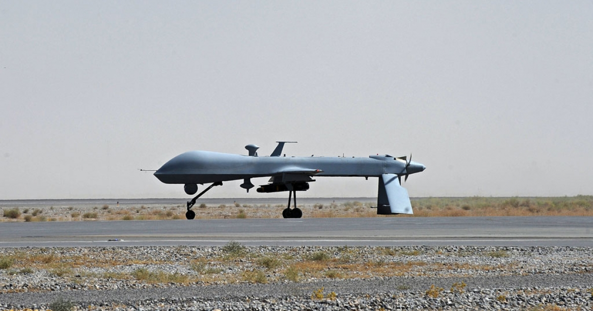 In this file picture taken on on June 13, 2010, a US Predator unmanned drone armed with a missile stands on the tarmac of Kandahar military airport.</p>