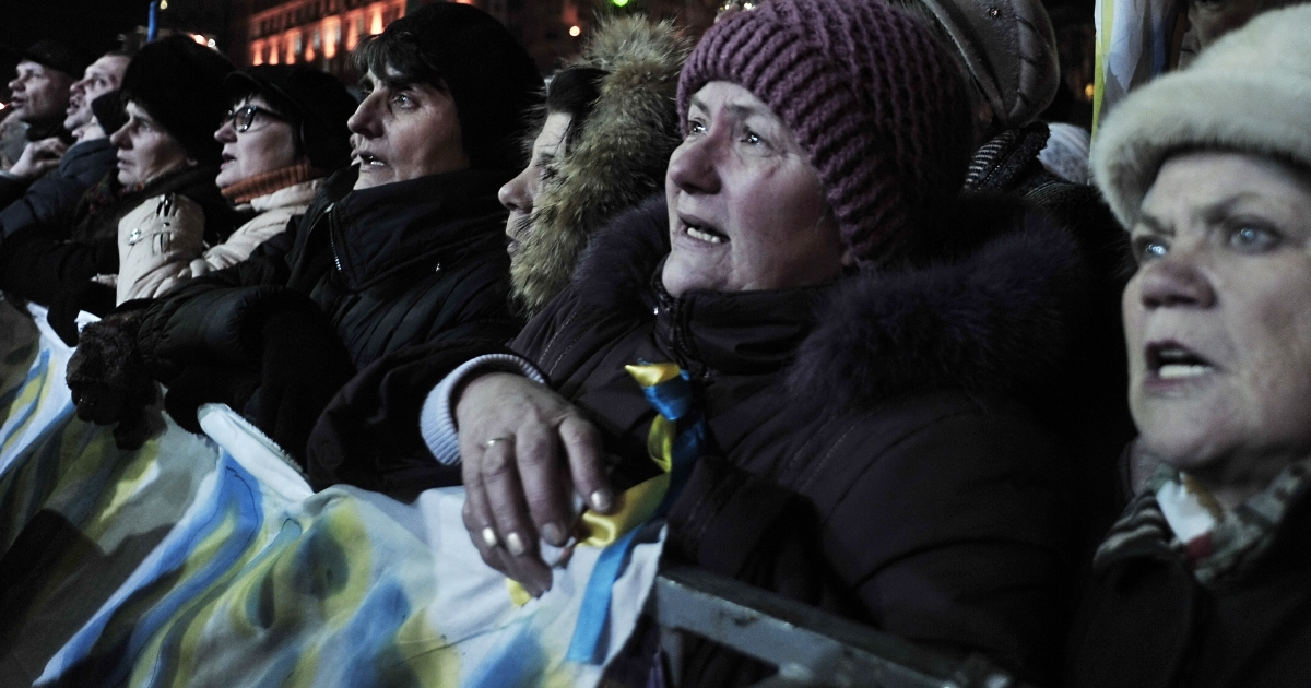 People on Kyiv's Independence Square on Wednesday listen to nominations of candidates for the new interim cabinet. Opposition leader Arseniy Yatsenyuk was named as the candidate for prime minister.</p>