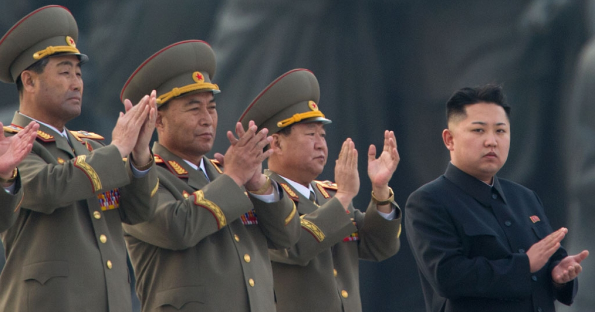 North Korean leader Kim Jong-Un (R) claps during the unveiling ceremony of two statues of former leaders Kim Il-Sung and Kim Jong-Il in Pyongyang on April 13, 2012.</p>