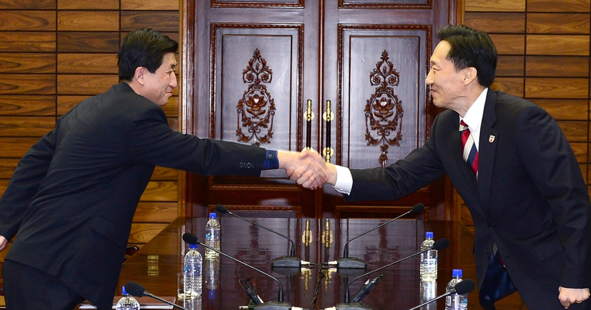In this handout provided by South Korean Unification Ministry, Lee Duk-Haeng (R), the head of South Korea's working-level delegation to family reunion shakes hands with his North Korean counterpart Park Yong-Il (L) during their meeting on February 5, 2014 in Panmunjom, North Korea.</p>