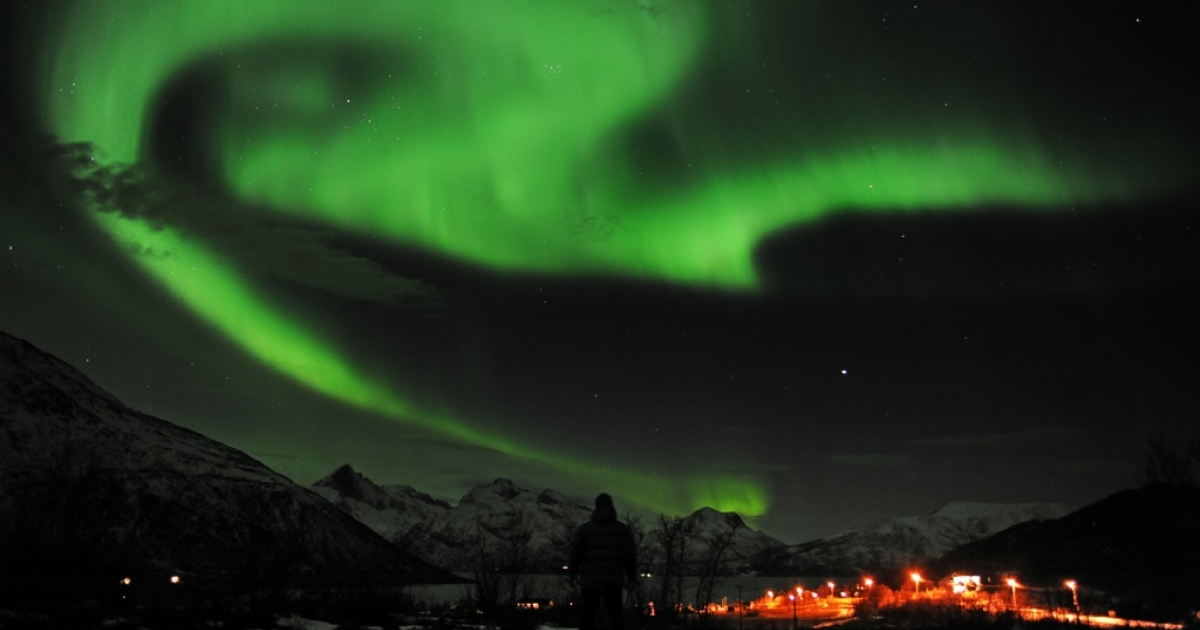 An Aurora borealis is pictured near the city of Tromsoe, northern Norway, late on Jan. 24, 2012.</p>