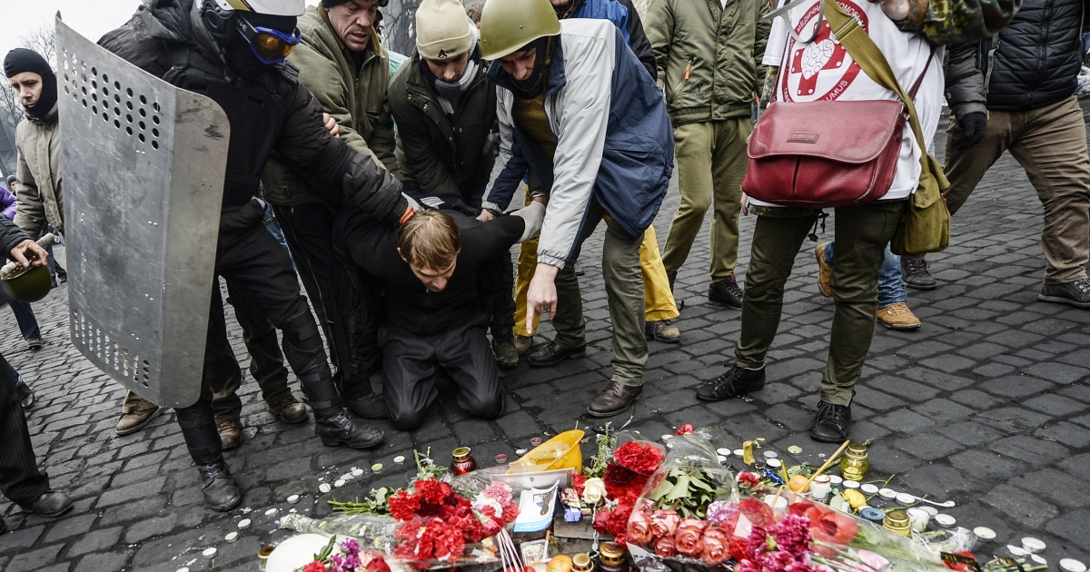 A man suspected by protesters of being a pro-government sniper is forced to pay his respects to a victim killed in the recent clashes. Amid the apparent power vacuum in Kyiv, fears remained on Feb. 22, 2014 over the potential threat of separatism in a country still largely split along cultural and linguistic lines.</p>