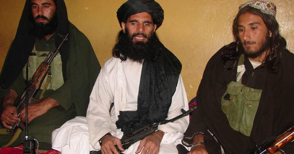This undated photograph shows Asmatullah Shaheen (C) talking with media in an undisclosed location in northwest Pakistan. Asmatullah Shaheen was ambushed in Dargah Mandi village near Miranshah, the main town of the troubled North Waziristan tribal district.</p>