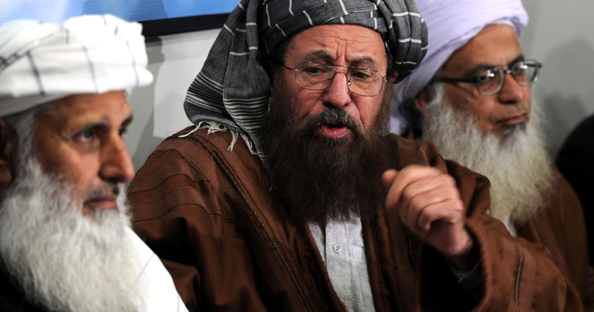 Members of a committee from Tehreek-e-Taliban Pakistan (TTP) which was set up to hold talks with the government of Pakistan speak with media representatives in Islamabad on February 4, 2014.</p>
