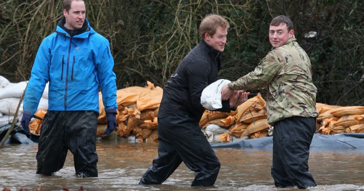 Prince William, Duke of Cambridge and Prince Harry help with flood defenses around Eton End School on Feb. 14, 2014 in Datchet, United Kingdom.</p>
