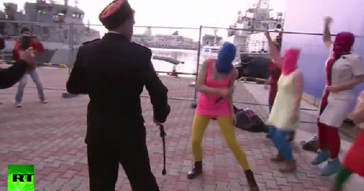 This screengrab from a video shows Russian Cossacks whipping members of Pussy Riot as they attempted to perform a song in downtown Sochi on Feb. 19, 2014.</p>