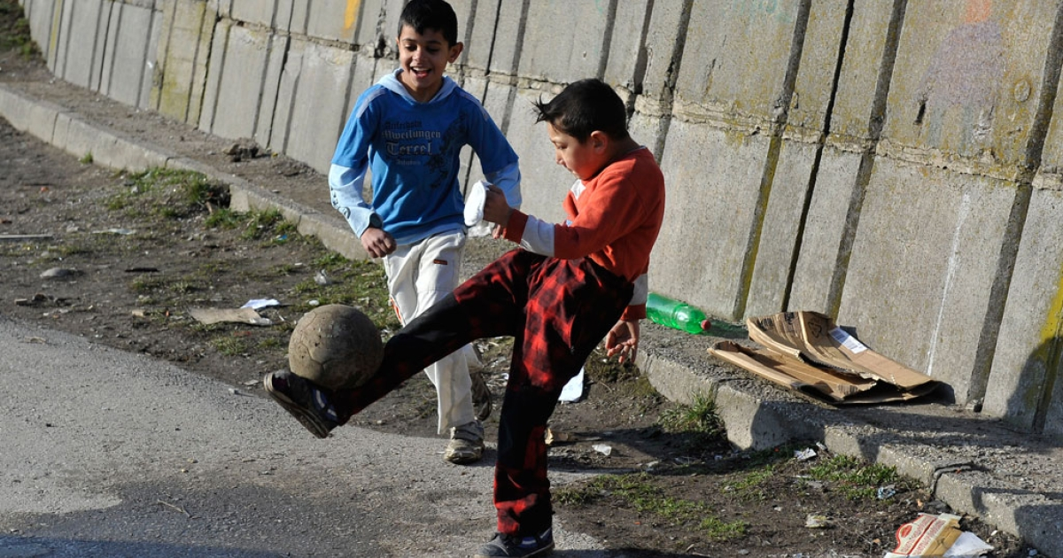Roma children play with a ball near their home in Brezno, central Slovakia on Feb. 5, 2014.</p>