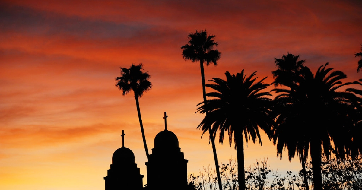 A sunset is seen above the two steeples of Good Shepherd Catholic Church on December 11, 2010 in Beverly Hills, California.</p>