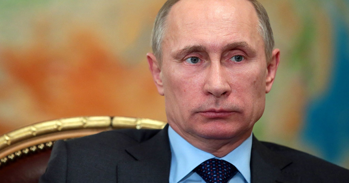 Russia's President Vladimir Putin attends a meeting in his Novo-Ogaryovo residence, outside Moscow on Feb. 26, 2014.</p>