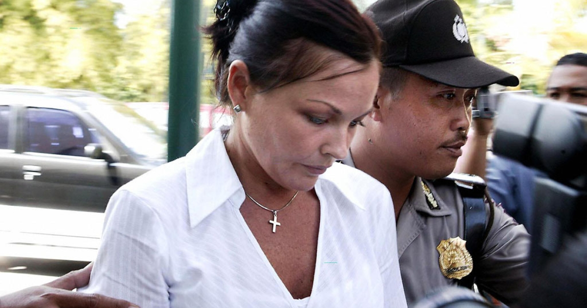 Australian Schapelle Corby arrives under Indonesian police escort before her trial in Denpasar, Aug. 3, 2005.</p>