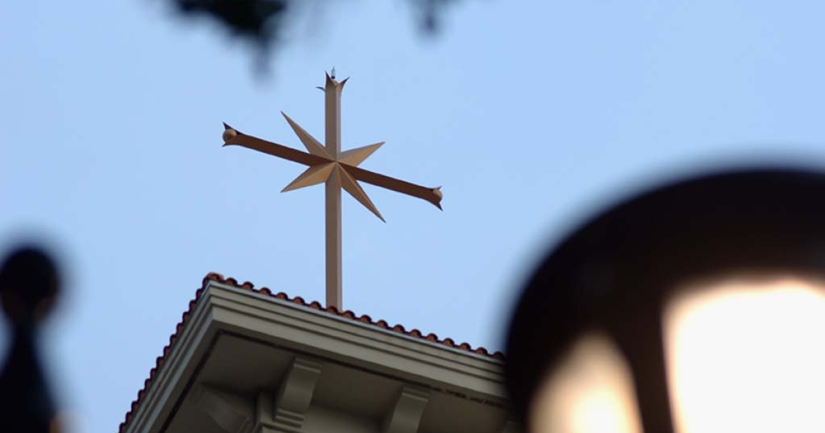 A cross sits on top of the Scientology Flag Building in Clearwater, Fla.</p>