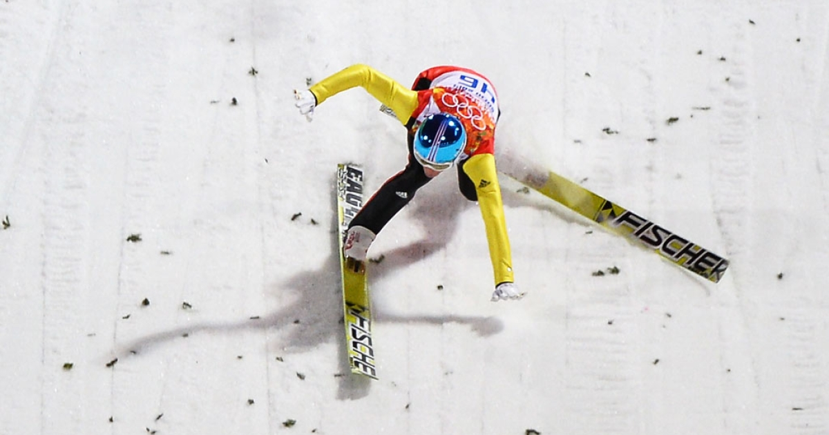 Germany's Severin Freund crashes during ski-jumping on February 9, 2014 at the Winter Olympics in Sochi, Russia.</p>