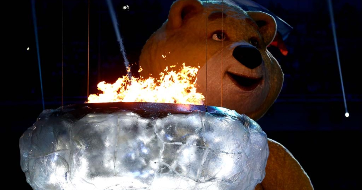 The polar bear mascot prepares to extinguish the Olympic flame during the Sochi Olympics closing ceremony, Feb. 23, 2014.</p>