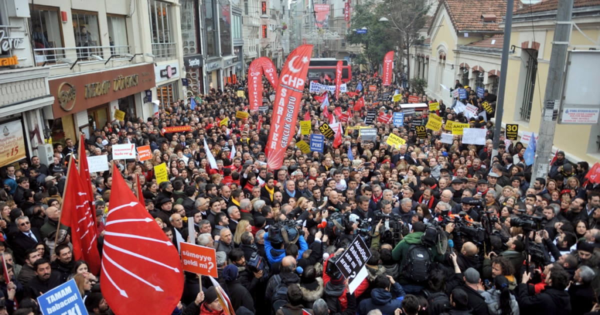 Supporters of Turkey's main opposition Republican People's Party shout slogans against the government during a demonstration on Istiklal Avenue in Istanbul.</p>