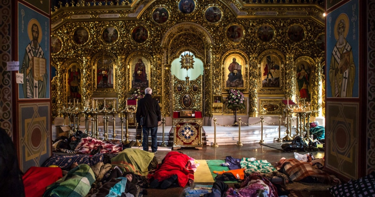 Anti-government protesters sleep on the floor inside the Mikhailovsky Monastery, which has been converted into a makeshift hospital, on Feb. 19, 2014 in Kyiv, Ukraine.</p>