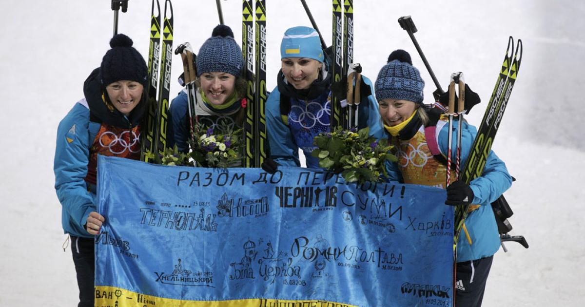 Vita Semerenko, Juliya Dzhyma, Olena Pidhrushna and Valj Semerenko of Ukraine celebrate after winning the women's biathlon relay at the Winter Olympics on February 21, 2014, in Sochi, Russia.</p>