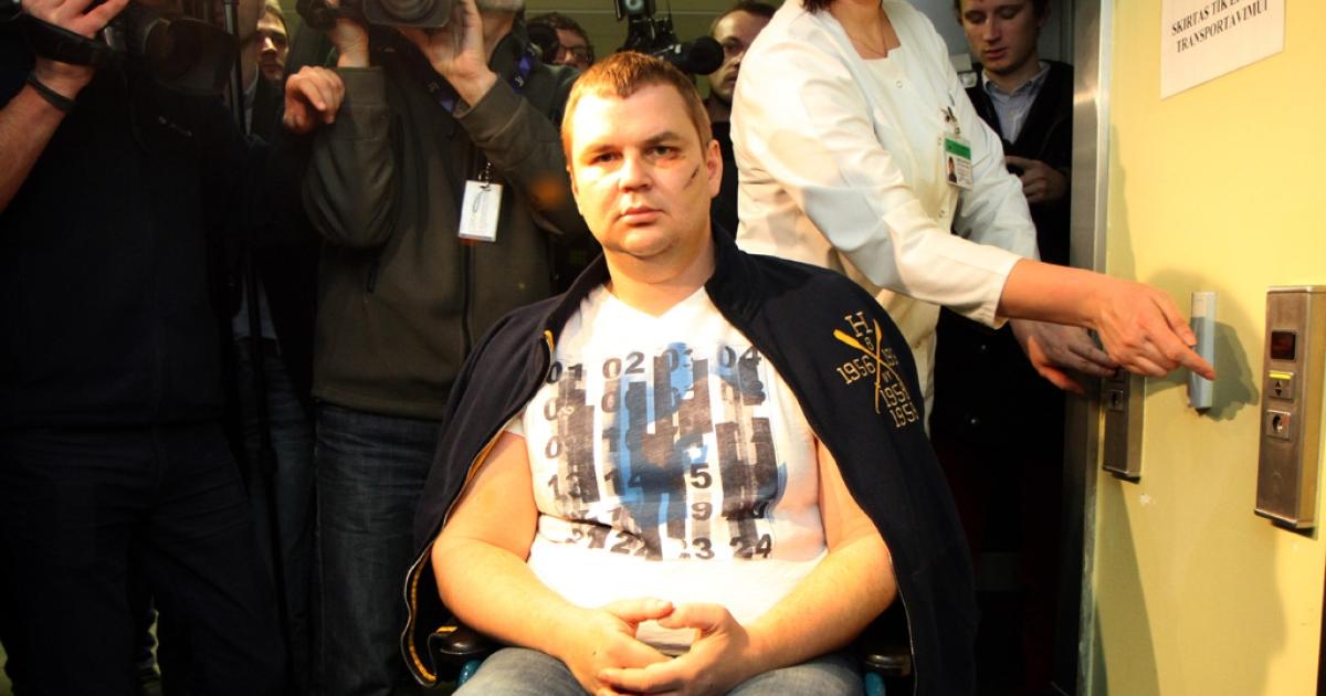 Ukrainian opposition activist Dmytro Bulatov leaves after addressing a press conference in Vilnius on February 6, 2014.</p>