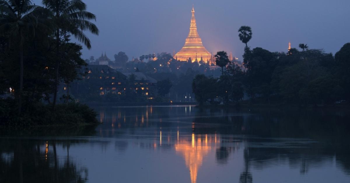 The Shwedagon pagoda is reflected in the Kandawgyi lake on Nov. 25, 2013 in Yangon, Myanmar.</p>
