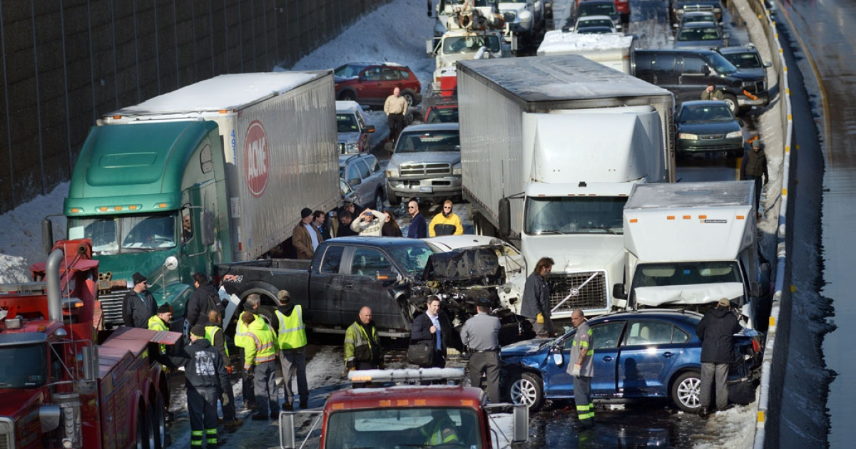 Rescue crews assist at the scene of a 100-car pileup on the Pennsylvania Turnpike on February 14, 2014 in Feasterville, Pennsylvania.</p>