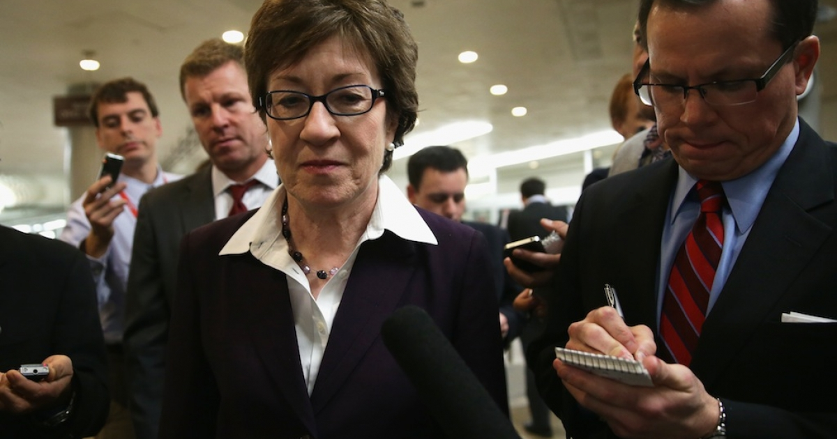 US Sen. Susan Collins (R-ME) speaks to members of the press as she is on her way for a vote January 6, 2014 on Capitol Hill in Washington, DC.</p>