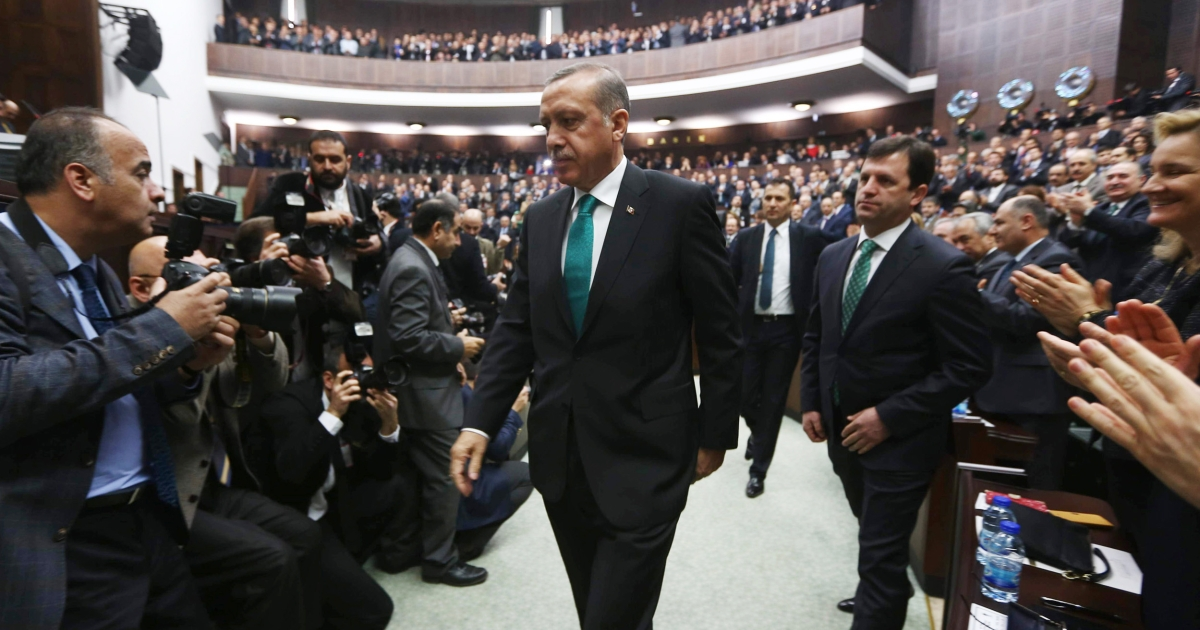 Turkey's Prime Minister Recep Tayyip Erdogan arrives to deliver a speech to the members of the Turkish Parliament in Ankara on January 14, 2014. Erdogan said his government was ready to withdraw a contentious bill curbing the power of judges — on certain conditions.