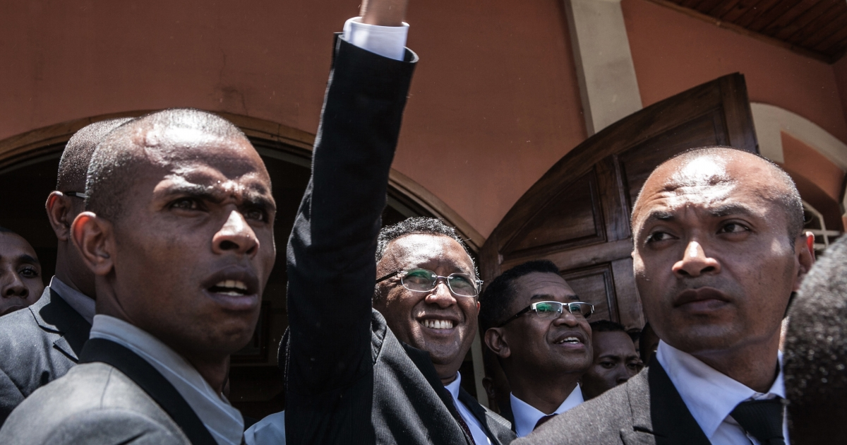 Hery Rajaonarimampianina (center) celebrates after being declared president of Madagascar by an electoral courthouse in Antananarivo on January 17, 2014.</p>