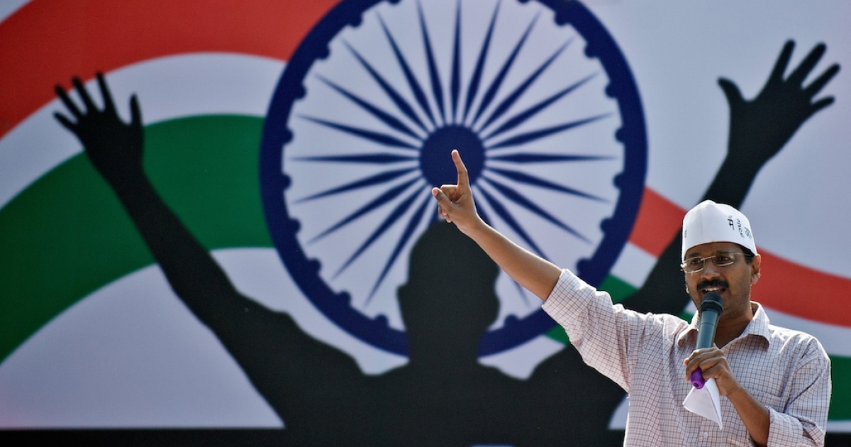 Activist turned politician Arvind Kejriwal gestures at a rally of the