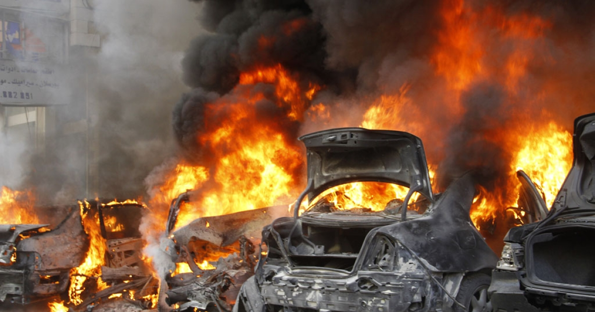 Smoke and blaze from burning cars are seen following an explosion on January 21, 2014 in Haret Hreik, a south Beirut neighbourhood considered a stronghold of the Lebanese Shia movement Hezbollah.</p>