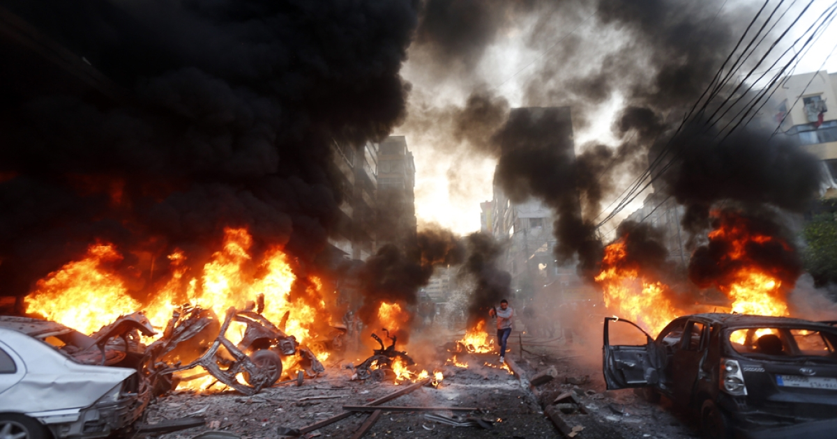 Flames rise from burning cars at the site of a car bomb that targeted Beirut's southern suburb of Haret Hreik on January 2, 2014. A large car bomb killed five people and wounded at least 20 in south Beirut, a health ministry source told AFP.</p>