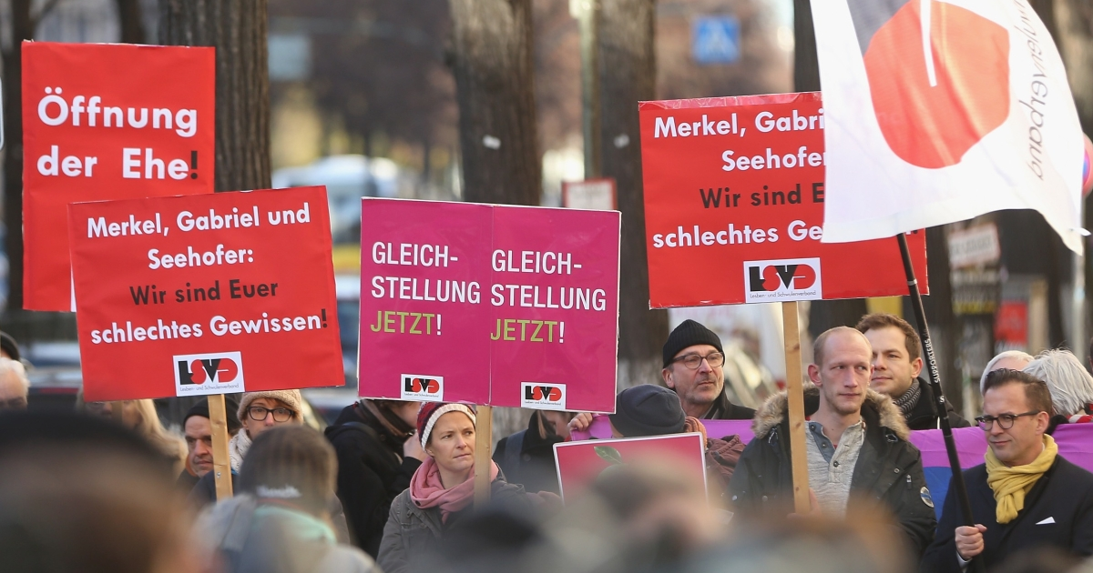 Demonstrators in Berlin advocate equal rights for gays and lesbians.</p>