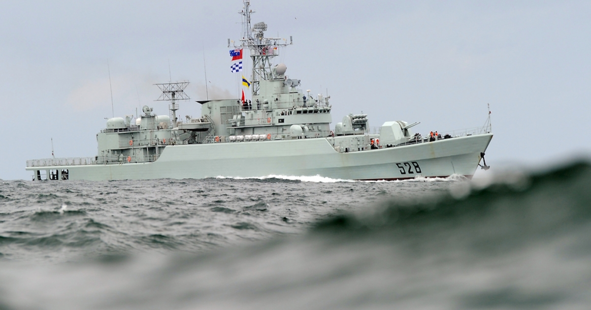 China's People's Liberation Army (PLA) naval frigate 'Mianyang' steams through the swell as it approaches Sydney Harbour on September 20, 2010. China is increasingly deploying risky confrontations as a means to expand its reach in the disputed South China Sea.</p>
