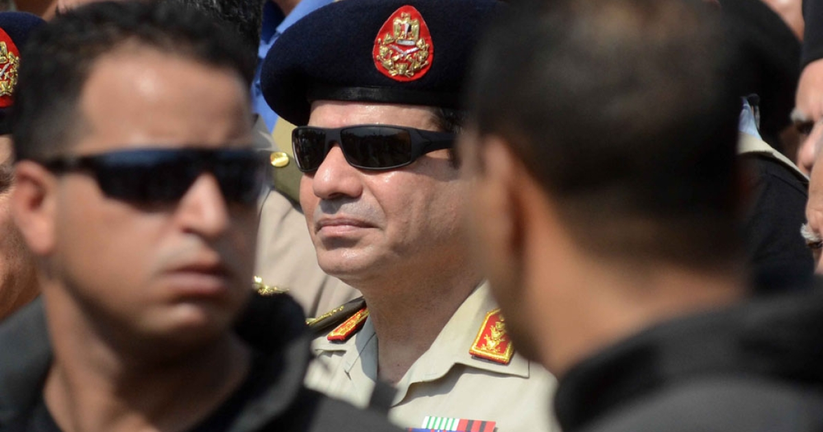 Egyptian Defense Minister and Military Chief General Abdel Fattah al-Sisi attends the funeral of Giza security chief Nabil Farrag outside Cairo on September 20, 2013.</p>