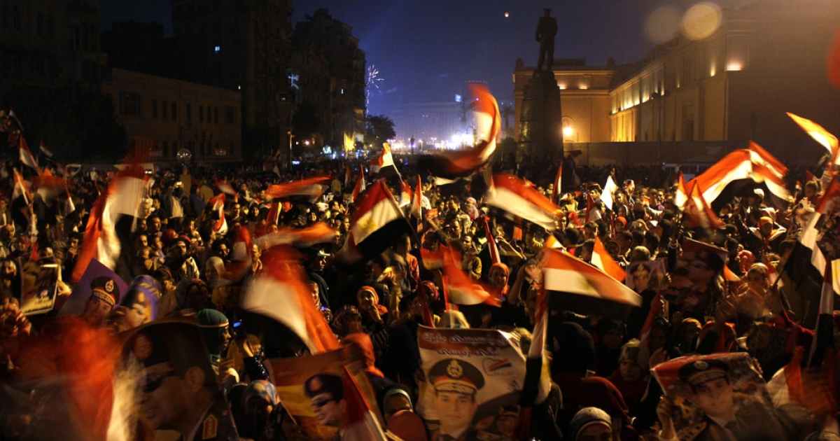 Egyptians gather at the edges of Cairo's Tahrir square, Jan. 25, 2014.</p>