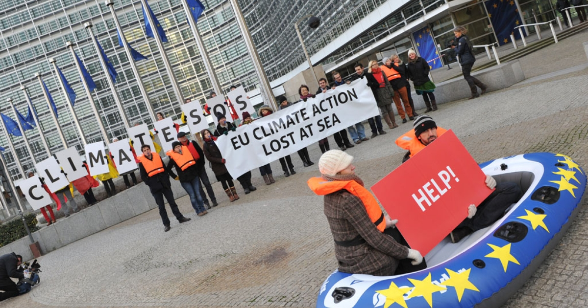 Activists demonstrate in support of climate objectives at the European Commission headquarters on January 22, 2014 in Brussels.</p>