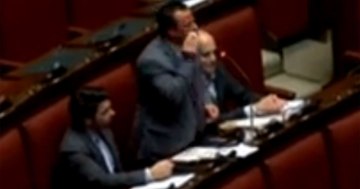 Gianluca Buonanno, a Northern League MP, uses a pad to apply black makeup during an anti-immigration rant in Italy's parliament on Jan. 16, 2014. He asked if Italians need to get a