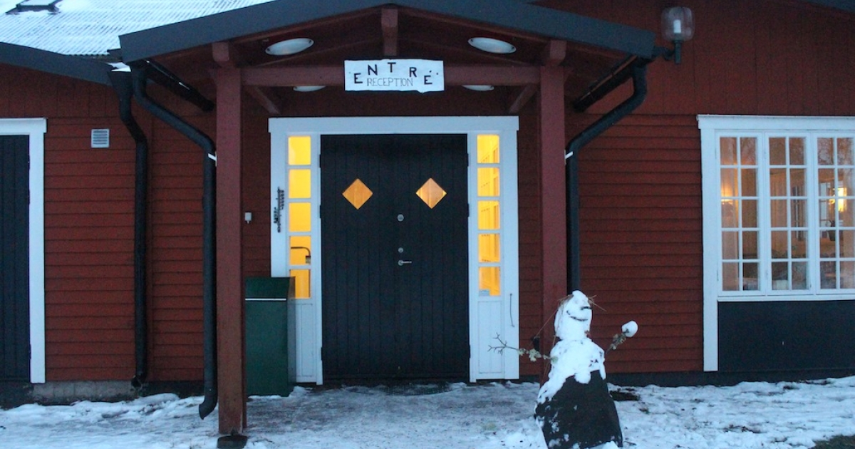 A snowman stands at the entrance of the hotel where the Swedish Migration Board temporarily accommodates asylum-seekers for free, located two hours north of Stockholm, Sweden.</p>