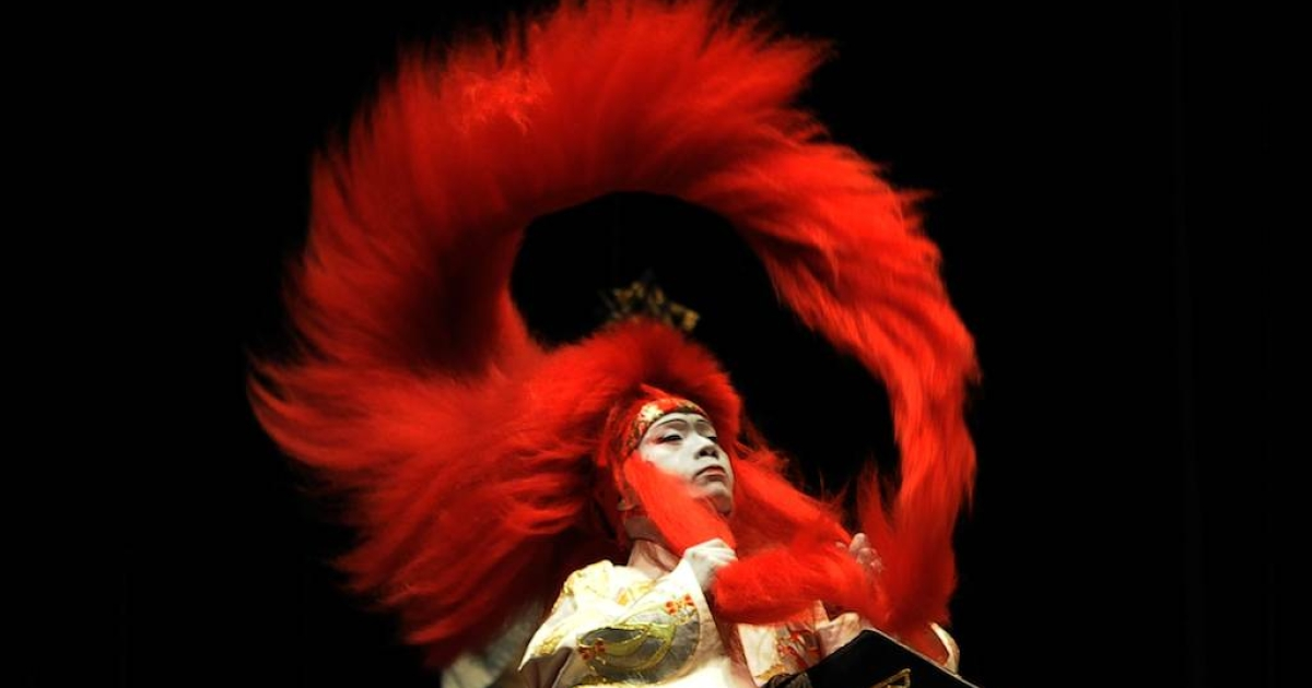 A Japanese actor performs during a presentation of a play called 'Saigmusume.' Kabuki Theatre is a highly stylized classical Japanese dance-drama. The related musical form, Nagauta, is powerful and dramatic, if alien to Western ears.</p>