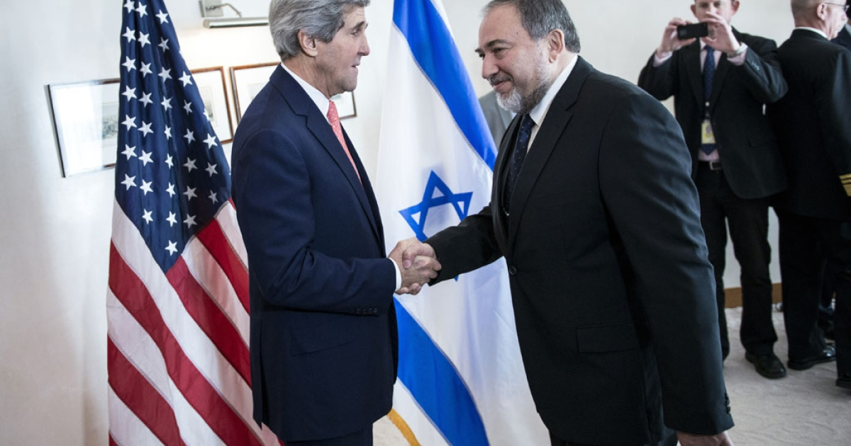 US Secretary of State John Kerry, left, greets Israeli Foreign Minister Avigdor Lieberman ahead of their meeting at the David Citadel hotel on January 3, 2014 in Jerusalem.</p>