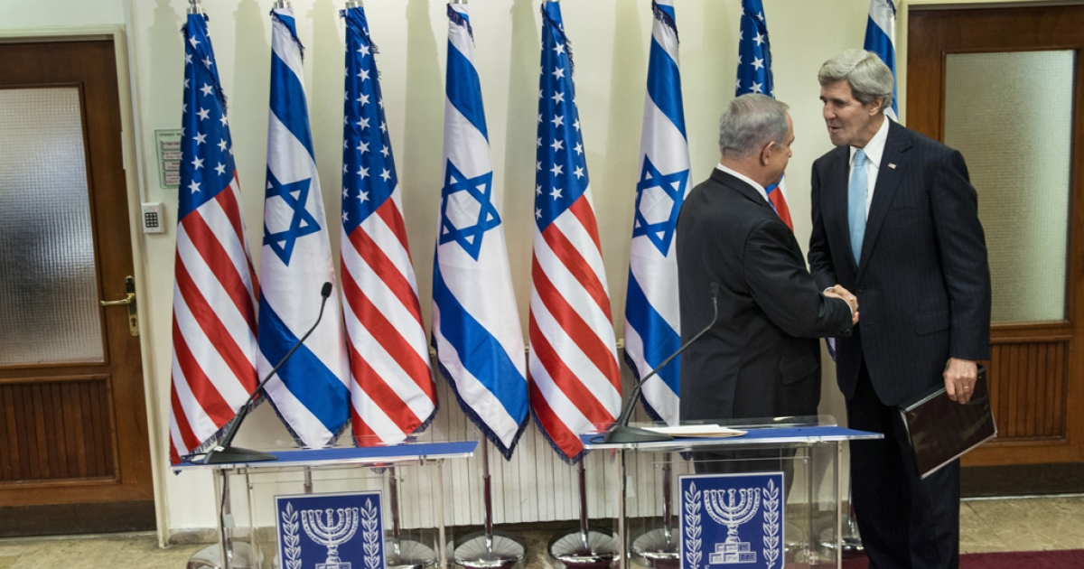 Israeli Prime Minister Benjamin Netanyahu (L) greets US Secretary of State John Kerry before a meeting at the Prime Minister's Office on January 2, 2014 in Jerusalem.</p>